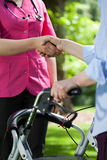 Doctor shaking hands with patient outdoors Stock Photography