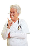 Doctor shaking her index finger Royalty Free Stock Images
