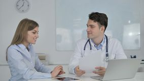 Doctor Sharing Good News with Patient, Holding Medical Report stock footage
