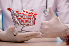 The doctor with shopping cart full of pills Stock Photos