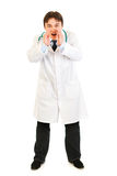 Doctor shouting through megaphone shaped hands Royalty Free Stock Photos