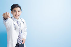Doctor show fist to you Royalty Free Stock Photos