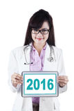 Doctor show number 2016 with tablet Stock Photo