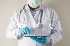 Free Doctor  Show Plese Contact Us Line Contact Hand Telephone  Email Address On Website Page Contact Us Or E-mail Royalty Free Stock Photography - 217045107