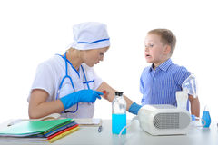 Doctor showed the boy how to make a injection Royalty Free Stock Photography