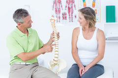 Doctor showing anatomical spine Stock Images