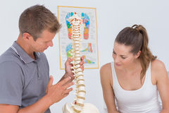 Doctor showing anatomical spine to his patient Stock Images