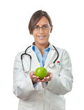 Doctor Showing an Apple with Both Hands. Doctor in Lab Coat Showing an apple with both hands as a perfect healthy eating example Royalty Free Stock Photography