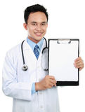 Doctor showing blank clipboard Royalty Free Stock Photography