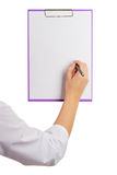 Doctor showing a blank sheet of paper to record Stock Photo