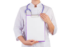 Doctor showing a blank sheet of paper to record Royalty Free Stock Photo