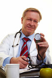 Doctor showing blood pressure meter Stock Photography