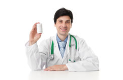 Doctor showing a bottle of pills Royalty Free Stock Photography
