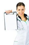 Doctor showing clipboard Stock Image