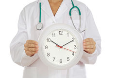 Doctor showing clock Stock Photos