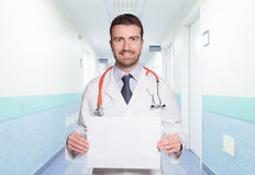 Doctor showing a copy space white board royalty free stock photo