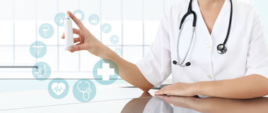 Doctor showing creme tube medicine, with icons Stock Image