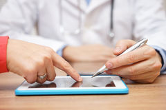 Doctor is showing digital prescription for medicine on tablet pc Royalty Free Stock Images