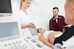 Doctor Showing Digital Tablet To Expectant Couple Royalty Free Stock Photo