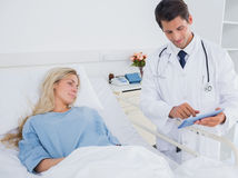 Doctor showing digital tablet Stock Photography