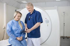 Doctor Showing Digital Tablet To Patient At MRI Machine Royalty Free Stock Photo