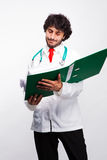 Doctor showing folder Royalty Free Stock Photos