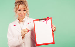Doctor showing folder with pink ribbon by pen. Royalty Free Stock Image
