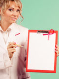 Doctor showing folder with pink ribbon by pen. Stock Image