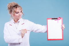 Doctor showing folder with pink ribbon by pen. Royalty Free Stock Photos