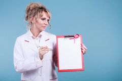 Doctor showing folder with pink ribbon by pen. Royalty Free Stock Photography