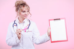 Doctor showing folder with pink ribbon by pen. Royalty Free Stock Photo