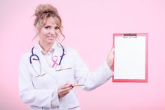 Doctor showing folder with pink ribbon by pen. Stock Photo