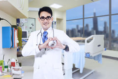 Doctor showing heart shape Stock Images