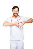 Doctor showing heart sign Stock Image