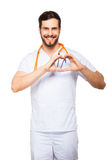 Doctor showing heart sign Stock Photo