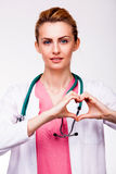 Doctor showing heart sign Royalty Free Stock Photos