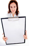 Doctor showing her blank clipboard Stock Image