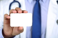 Doctor showing his business card Stock Photography