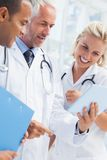 Doctor showing his tablet Stock Image