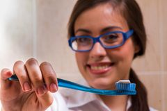 Doctor showing how to clean teeth Stock Photography
