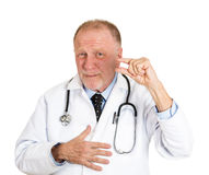Doctor showing just a little bit Royalty Free Stock Image