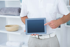 Doctor showing laptop pc. In medical office Royalty Free Stock Photography