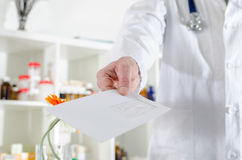 Doctor showing a letter Royalty Free Stock Photo