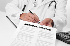 Doctor showing a medical history Stock Photography