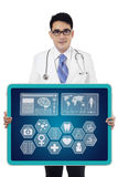 Doctor showing medical icon Royalty Free Stock Image