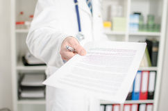 Doctor showing medical notes Stock Photography