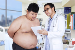 Doctor showing the medical notes Stock Image
