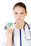 Doctor showing medical pills Stock Image