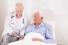 Doctor showing medical test resulst Stock Photography