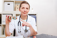 Doctor showing medicine in office Royalty Free Stock Photo